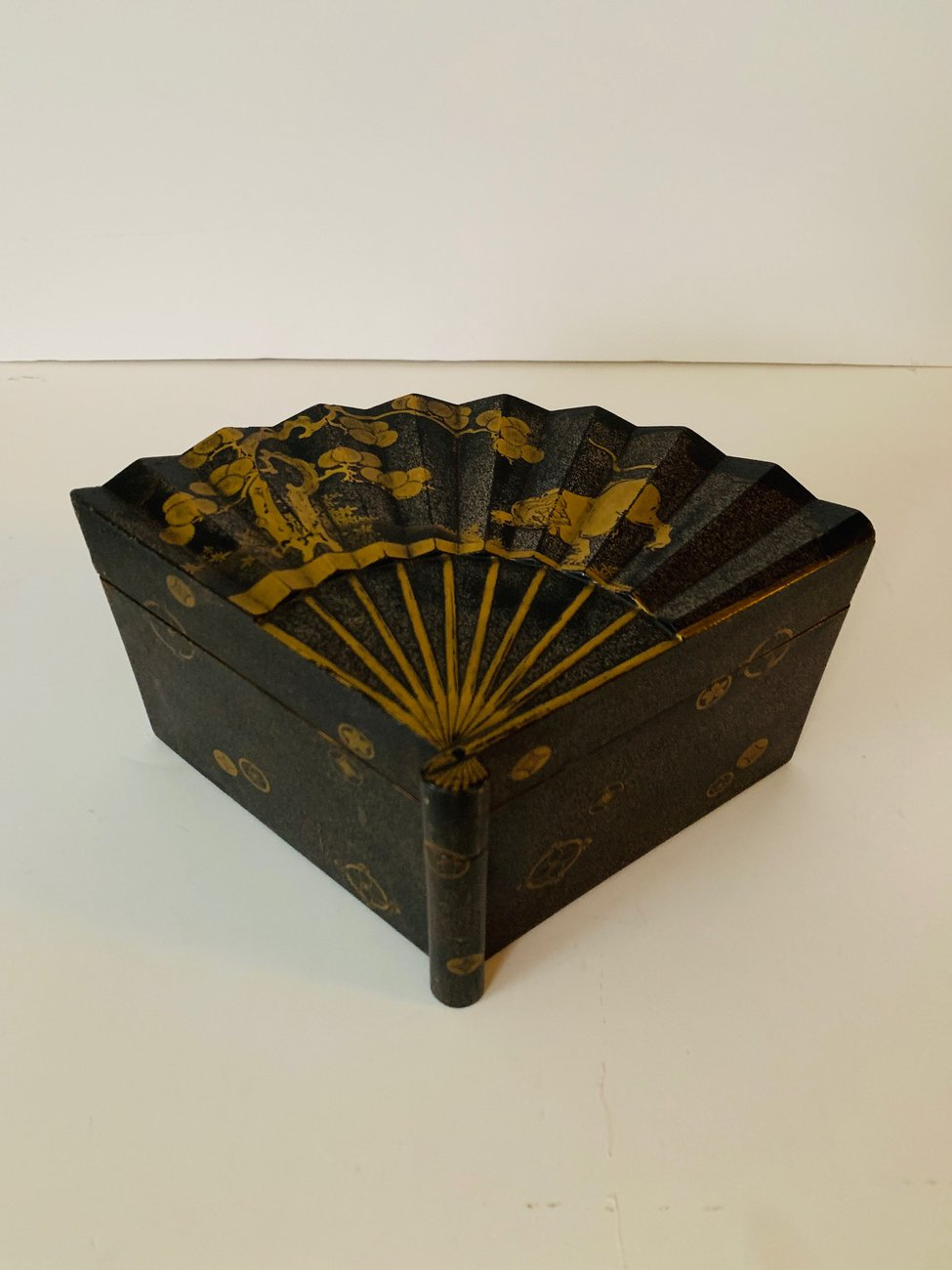 Preview image for A Japanese Lacquer Box of Inro-Buta-Zukuri type in the form of a fan, decorated in nashijiand gold hirakami on a black background