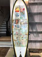 Surfboard by Nature Shapes with pages from Surf Journals