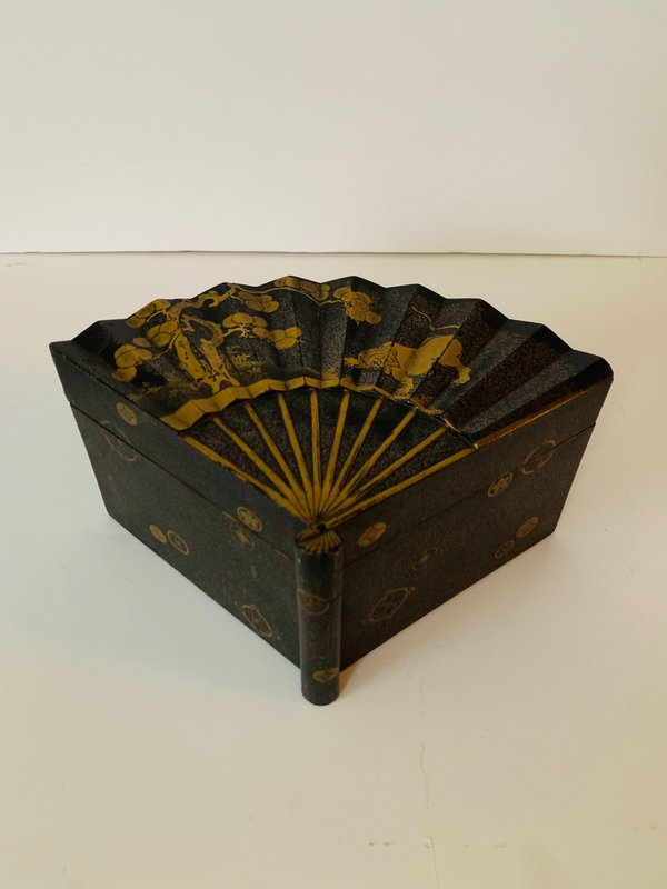 A Japanese Lacquer Box of Inro-Buta-Zukuri type in the form of a fan, decorated in nashijiand gold hirakami on a black background